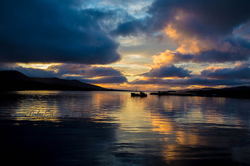 Fishing boat in Kenmare Bay sunset